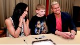 Dolph Ziggler and AJ Lee greet the WWE Universe at a WrestleMania Reading Challenge in New York City.