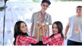 The Bella Twins meet members of the WWE Universe at the 2013 Special Olympics Connecticut Summer Games.