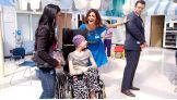 The Host of SummerSlam jokes around with one of his teenage fans at Children's Hospital Los Angeles.
