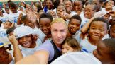 Tyler Breeze takes a selfie with the kids at the Barnett Rec Center.