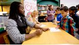 """Kofi and Natalya sign autographs for the kids after they read """"Otis."""""""
