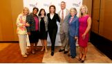 Cena poses with members of Komen's Board of Directors.