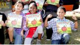 The kids pose with their new books courtesy of We Give Books, WWE and The Pearson Foundation.