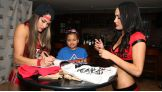 The Bellas sign autographs for the 10-year-old from Dallas.