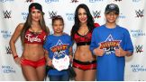 The Bella Twins are all smiles with Georgia and her family before their in-ring argument at SummerSlam.