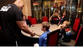 The Rock greets Thomas and his family at the American Airlines Arena before Raw in Miami.