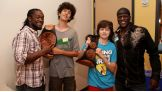 Kofi Kingston & R-Truth share their championship gold with two young members of the WWE Universe.