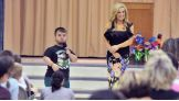 The WWE Superstar talks to the Pleasant Garden Elementary School students about the be a STAR anti-bullying initiative.