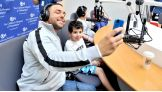 Santino snaps a photo with one of his young interviewers.