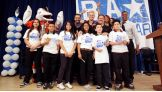 T.D., Durbin, Otunga, and Russell pose with the children of Hialeah Middle School.