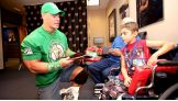 Joseph, 7, talks to his favorite WWE Superstar before Raw 1,000 in St. Louis.