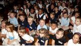 The kids from the William Cullen Bryant Elementary School in Cleveland listen to the WWE Superstar.