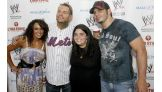 The Superstars and Divas posed for photos with many WWE fans.