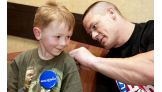 Dillon Willis, 10, of Louisville, meets Cena in May 2009.