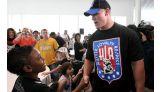 Cena greets the overjoyed Wish Kids in Houston.