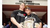 John Cena and one of the Wish recipients share a golden pose.