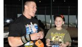 Camron Villanueva, 8, of West Jordan, Utah, meets Cena in Salt Lake City.