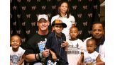 Shaunquis Daniels, 10, of Baltimore, and his family meet Cena in July 2008.
