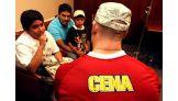 Kevin Vargas, 13, of Ocean Township, N.J., talks to Cena.