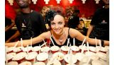 Maria serves up sundaes and a smile at Cold Stone.