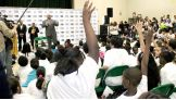 The World's Largest Athlete takes questions from the children in attendance.