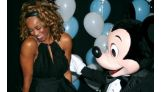 The Diva shares a moment with Mickey Mouse.