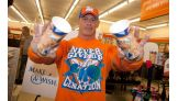 John Cena shows off his Cup with a Cause coffee cups at 7-Eleven.