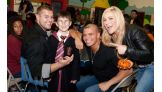 The Hart Dynasty poses with a Harry Potter look-a-like.