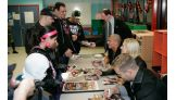 The Hart Dynasty signs autographs for partygoers at the fundraiser.