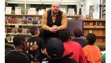 Big Show talks to children at the Burroughs & Saden Library in Bridgeport.