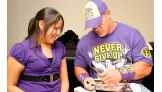 Cheyanne Kinney gets an autograph from John Cena.