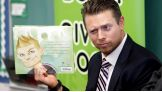The Miz takes a look at his likeness on the back of Foley's new children's book.