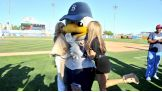 Sandy, the Cyclones' mascot, gets a little love from the Divas.