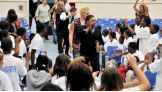 Otunga, The Miz and Lilian Garcia get ready to rally the students at John F. Kennedy Middle School in North Miami Beach.