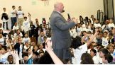 Big Show walks out to get closer to the students as he tells them about how he was bullied as a child.