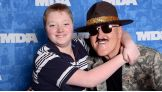 Sgt. Slaughter gets a hug from Cole Manno. The MDA Muscle Team event raised more than $364,000!